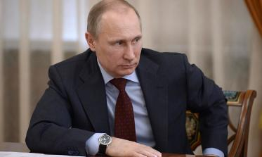 Vladimir Putin chairs a meeting at the Novo-Ogaryovo state residence outside Moscow
