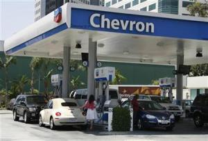 Motorists are shown at gas pumps at a Chevron gasoline station in Burbank